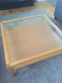 clear glass square top brown wooden coffee table Nacka, 132 34