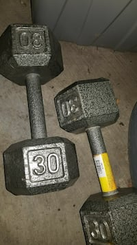two black 30lbs dumbbells