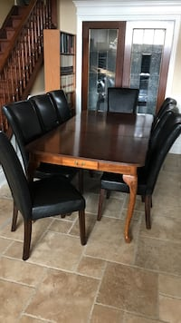 Rectangular brown wooden table with 8 chairs dining set