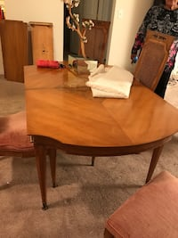 oval brown wooden dining table Deptford Township