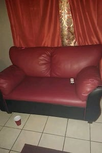red leather sofa chair with throw pillow Las Vegas, 89115