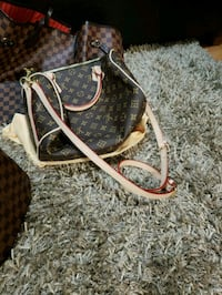 brown and black Louis Vuitton leather backpack Vancouver, V5V 2X9