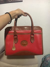 red and brown Dooney & Bourke leather handbag