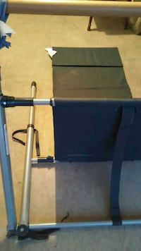 Gray Pilates fitness equipment comes with instructional videos (DVDs).