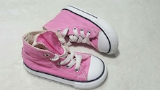 children's pink-and-white high top sneakers
