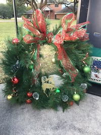green wreath with ribbon and baubles San Antonio, 78231
