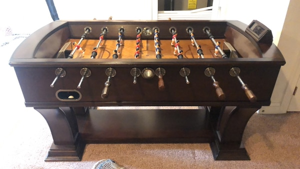 Brown and black foosball table