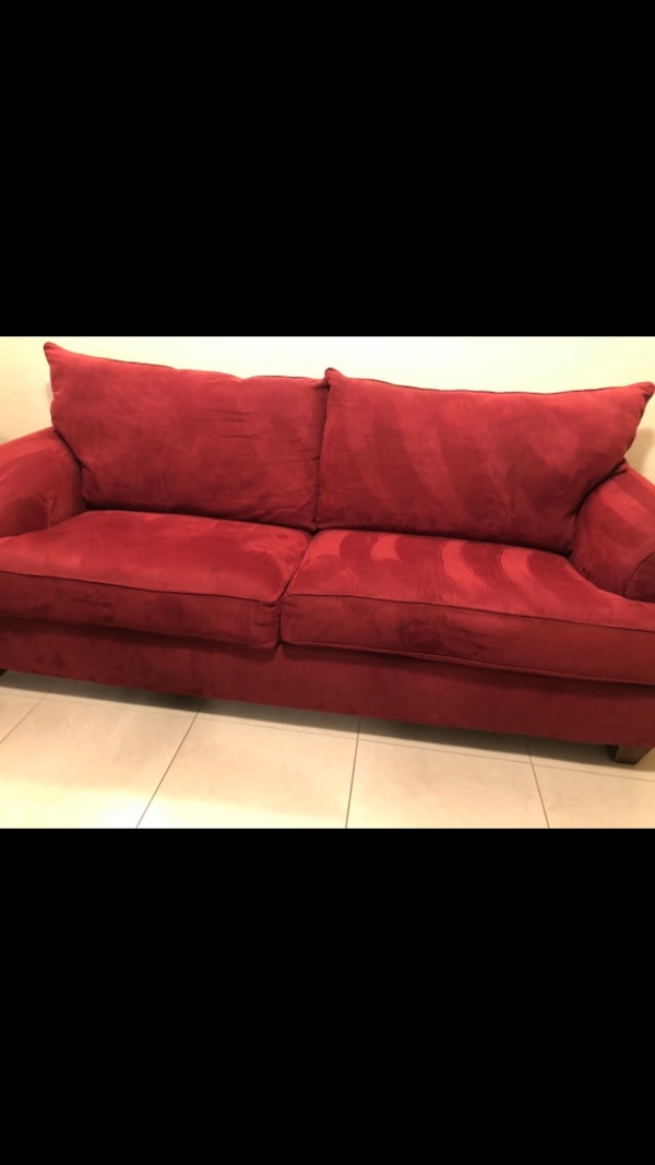 Used Red sleeper couch.. for sale in Palm Bay - letgo