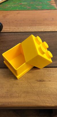 Yellow LEGO storage box. Paper clips. Coins   Toronto, M3A 0A4