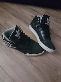 pair of black-and-white Adidas basketball shoes