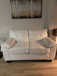 Off-white faux leather loveseat