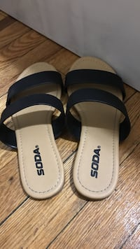White-and-black soda leather slide sandals
