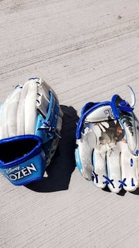 two blue and white baseball mitts Calgary, T1Y 1X7