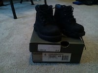 pair of men's black high tops with box Kansas City
