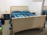 beige wooden sleigh bed frame with blue and white stripe bedding set Mississauga, L5M 8C3
