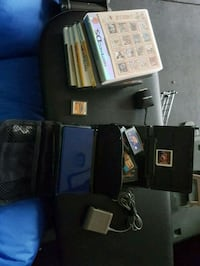 black Nintendo DS with game cartridges West Vancouver