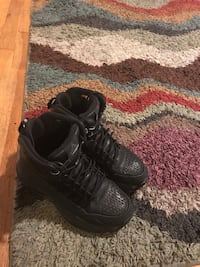 Pair of black nike air force 1 low shoes