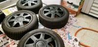 195/55/15 winter tires on the mags and two rims.   Longueuil, J3Y 4K2