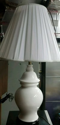 White porcelain based lamp with white lampshade.
