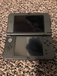 black Nintendo DS with game cartridge Lloydminster (Part), S9V 0A2