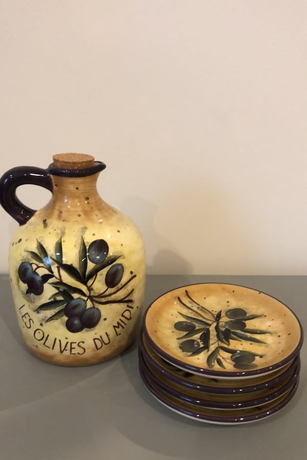 Olive oil carafe and appetizer plates f1b6178f-c52f-4901-ad92-f5b8bee9f687