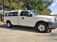 FORD F 150 work truck in great condition and low miles, 99000 miles long bead with pick up shell. WORKS GREAT, AC HEAT WINDOWS, NEW EMISSIONS AND THE TITLE IS CLEAN 2 previous owner and no accidents. Call for more information four zero four seven two fiv Duluth, 30097