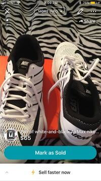 Pair of black-and-white nike running shoe ( size 11) Brand New, never been worn .
