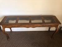 brown wooden framed glass top coffee table El Paso, 79907