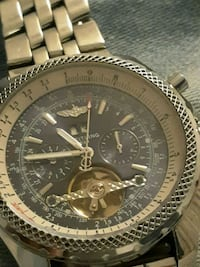 round silver-colored chronograph watch with link b Garland, 75043