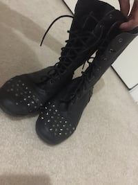 pair of spiked lace-up mid-calf boots