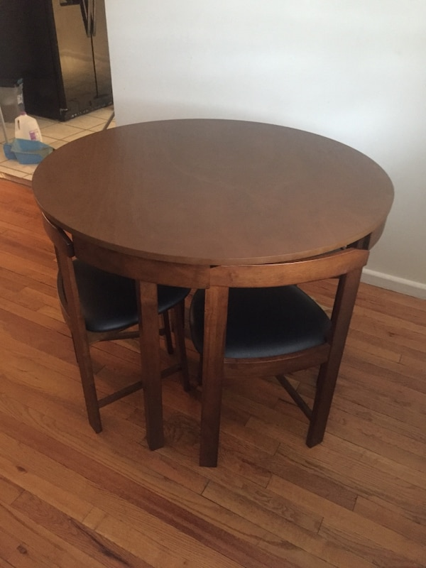 Round brown wooden side table in excellent condition