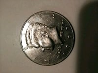 round silver-colored coin Houston, 77063