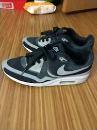 pair of black-and-white Nike running shoes Chicago, 60625