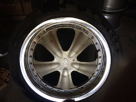 """Four 17"""" mustang rims with three tires.good condition"""