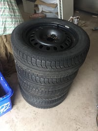 4 Michelin x-ice winter tires with steel rims 225/55R17