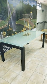 rectangular black wooden table with two chairs London, N6E 2Y2