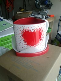 Avon heart shaped mugs with coster