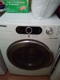 white LG front-load clothes washer 751 mi