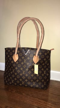 brown Louis Vuitton leather tote bag Justice, 60458