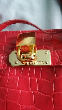 Faux red leather bag. with gold buckle Fort Erie, L2A 2N1
