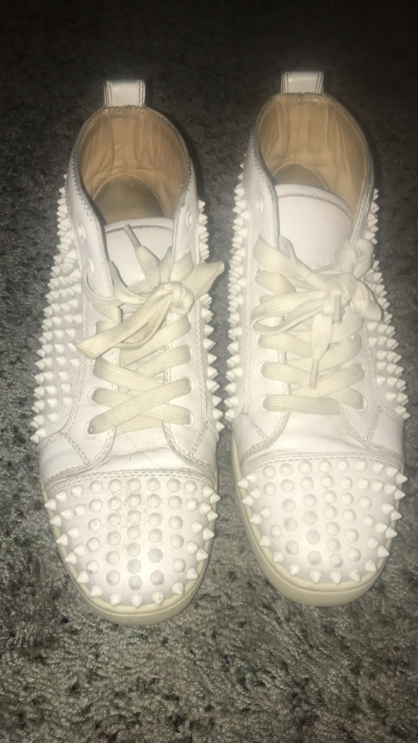 pair of studded white leather low-top sneakers
