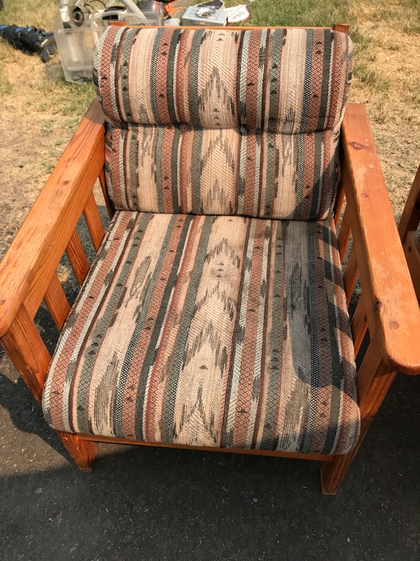 Brown and black wooden armchair