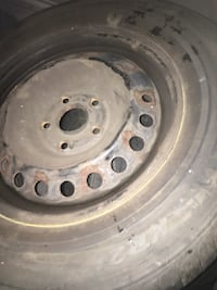 Gray bullet hole car wheel with tire Allentown, 18102