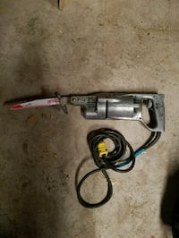 black and gray corded power tool Lake Station