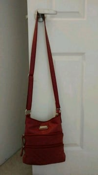 Red leather crossbody bag with lots of pocket