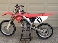 red and white Honda motocross dirt bike Mission, V2V