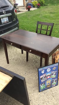 Brown table with a chair  Guelph/Eramosa, N1H 6J1