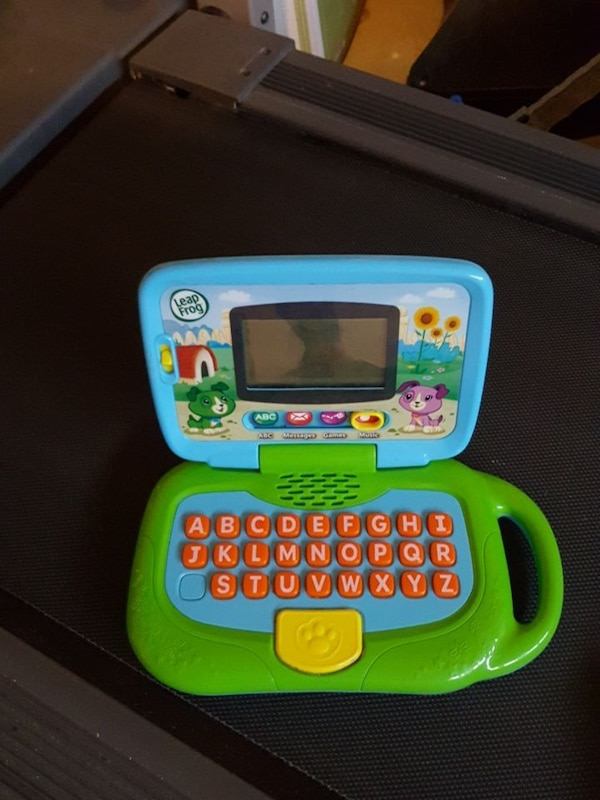 baby's green and blue Leap Frog reader