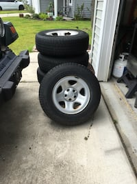 Set of 5 p215/75r15 tires on stock Jeep TJ rims (one never used tire, the rest 80%+ tread) Mount Pleasant, 29466