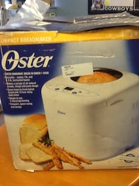 white and black Rival Crock-Pot slow cooker box 68 km